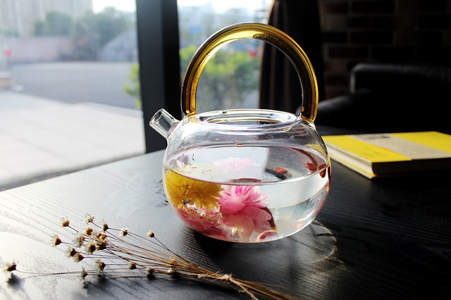 glass teapot infusing blooming tea